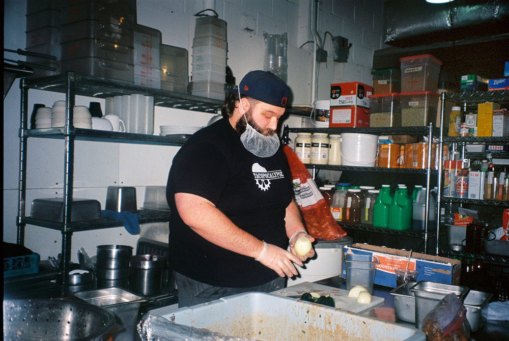 Geno chops vegetables during his shift as a general manager at Tacopacalypse in Des Moines. He dreams of one day owning a restaurant.