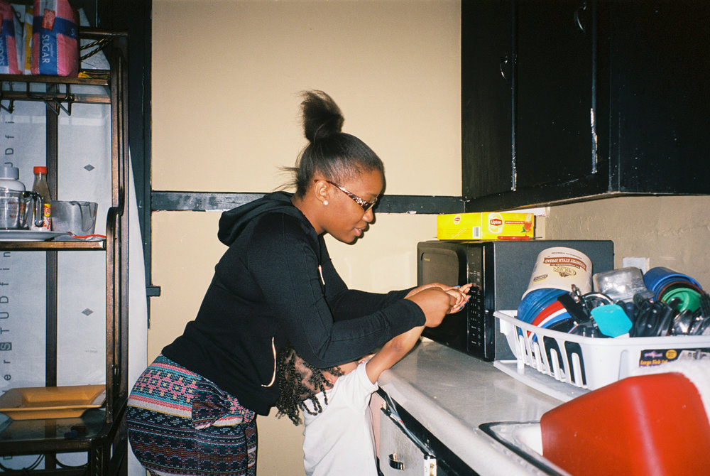 Chamira assists her son, A'mauri, defrost Pizza Rolls at the home they share together in Danville. After discovering that A'mauri was born with autism, Chamira started her journey to attend nursing school and works as a certified nursing assistant at a local nursing home.