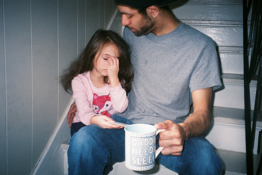 Tyler comforts his five-year-old daughter, Eisley, after awakening her from a nap at their home in Danville. Tyler works long hours at the Thyssen Krupp factory, where he makes camshafts for cars. He aspires to be a gym teacher and basketball coach.