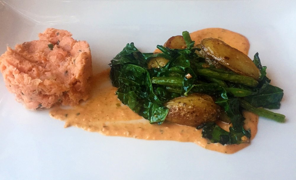 Smoked salmon rillettes with confit fingerling potatoes, haricots verts, wilted kale, and tomato-caper aioli