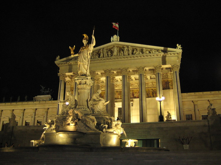 Austrian parliament building at night. Markus Bernet/ Wikimedia