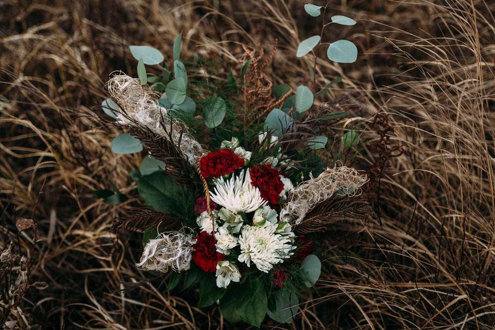 Paper peony flowers with dried fireweed