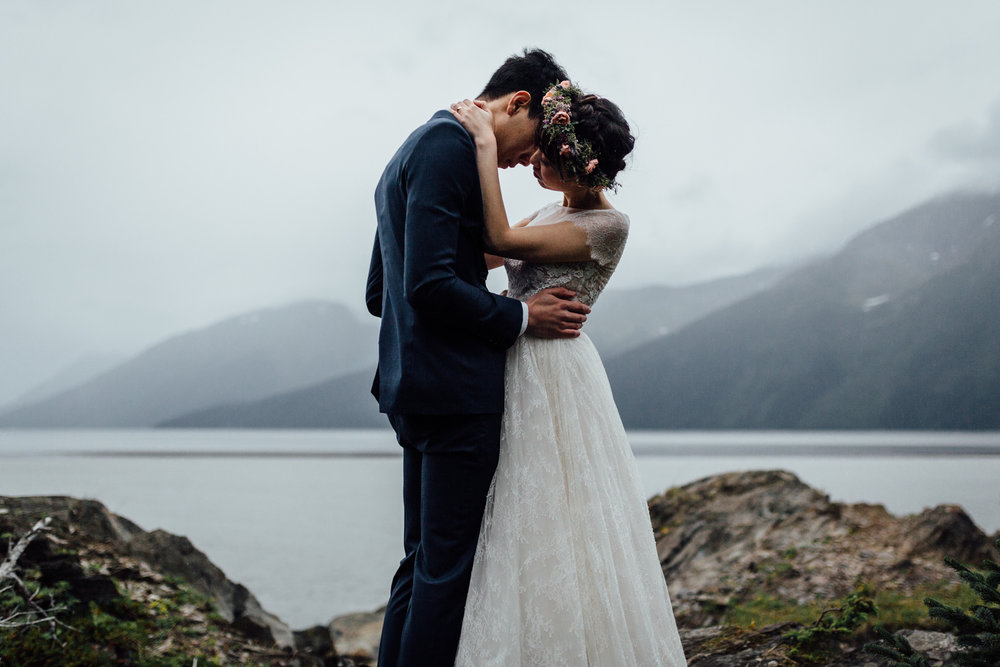 Bride and groom kissing in Alaska