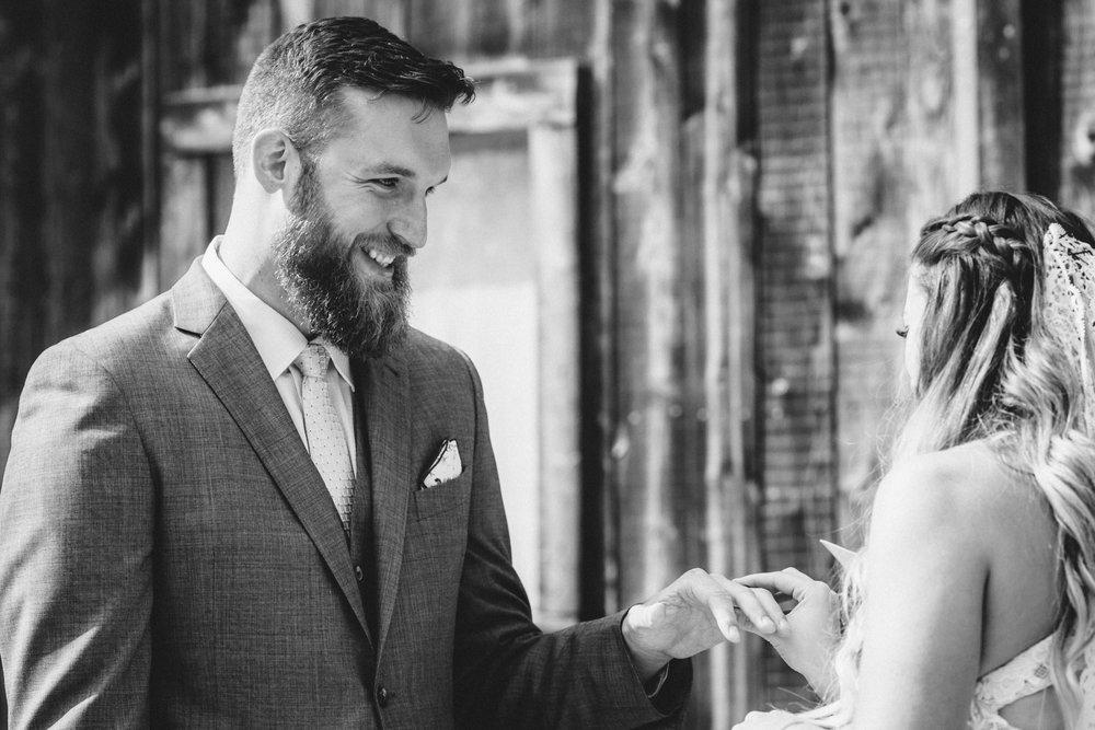 Groom tearing up as bride puts on wedding ring