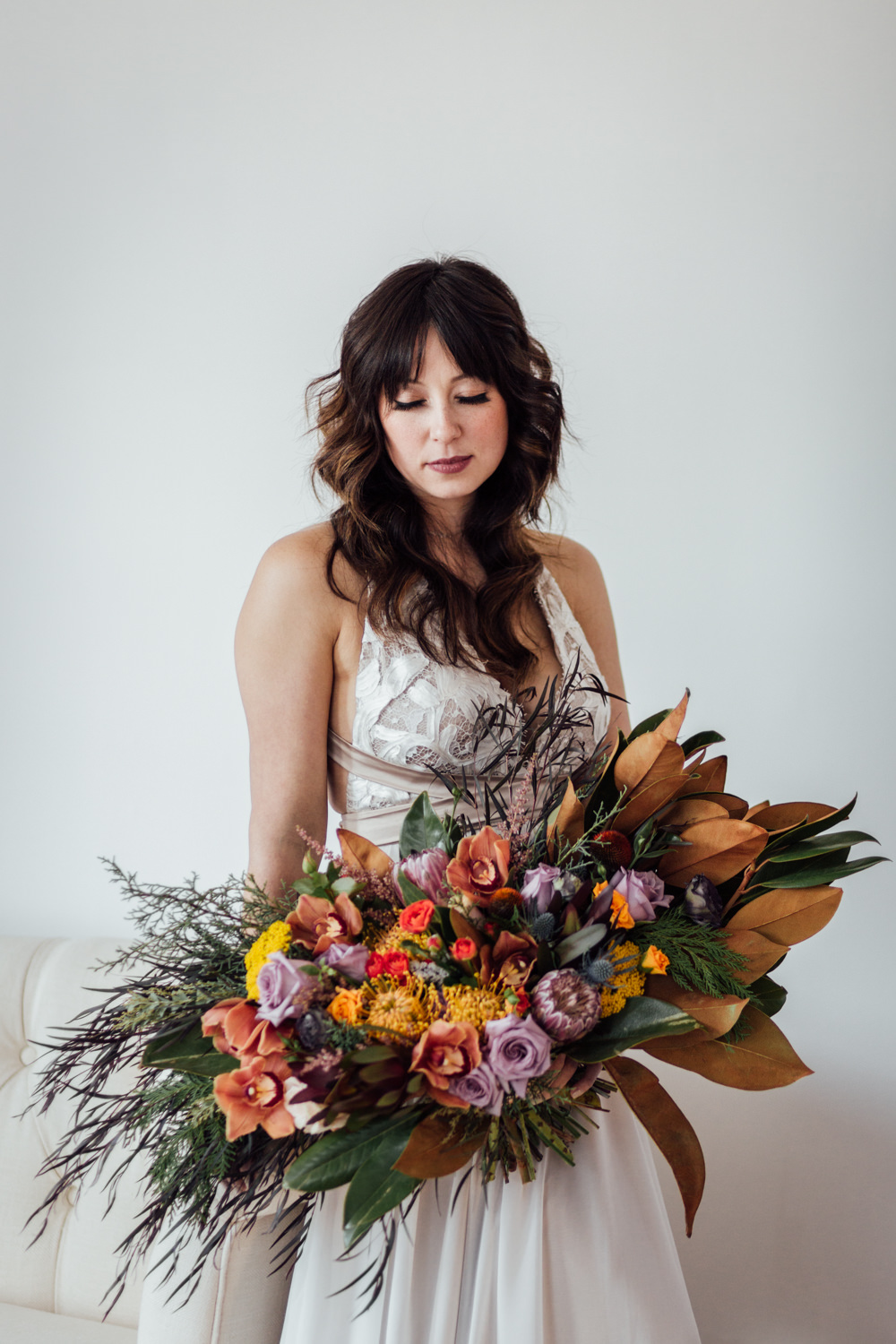 Alaska bride with Blomma Designs florals