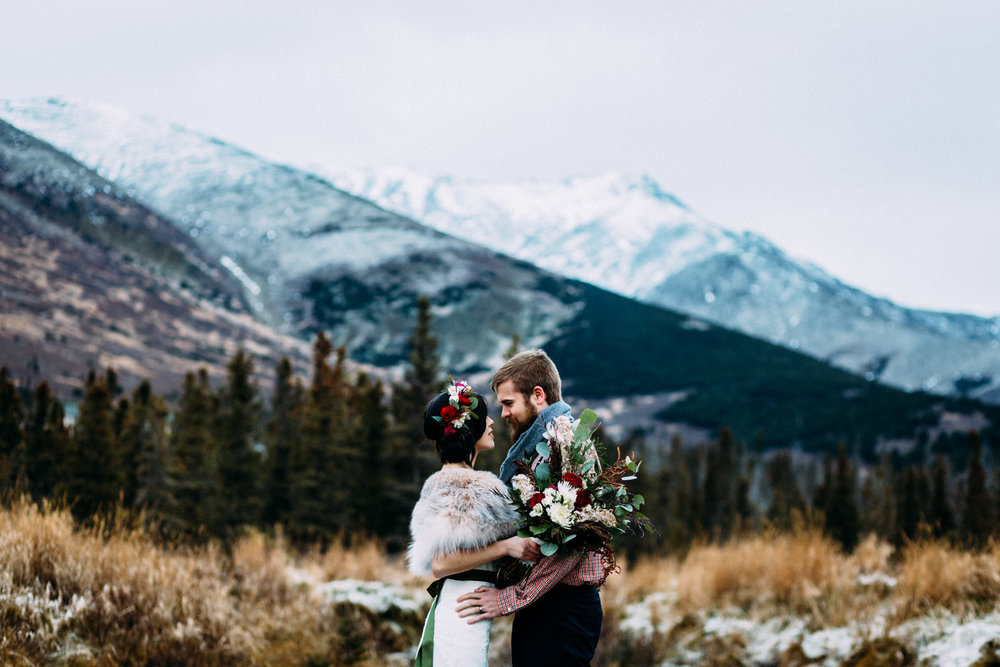 Bride and groom in front of Chugach Mountains