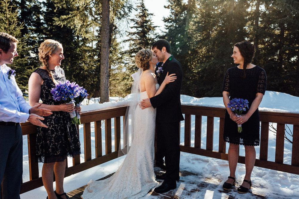 First kiss during backyard wedding