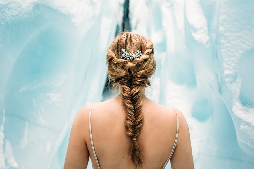 Bride with long braid in ice cave