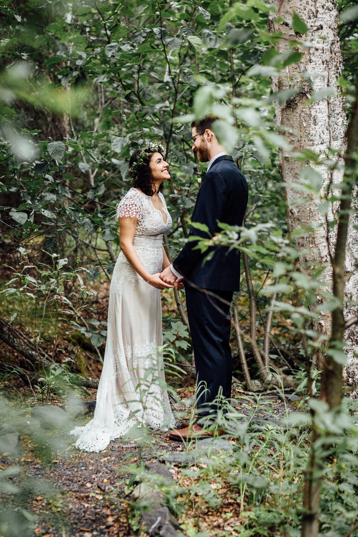 Sweet moment between couple in Cooper Landing forest