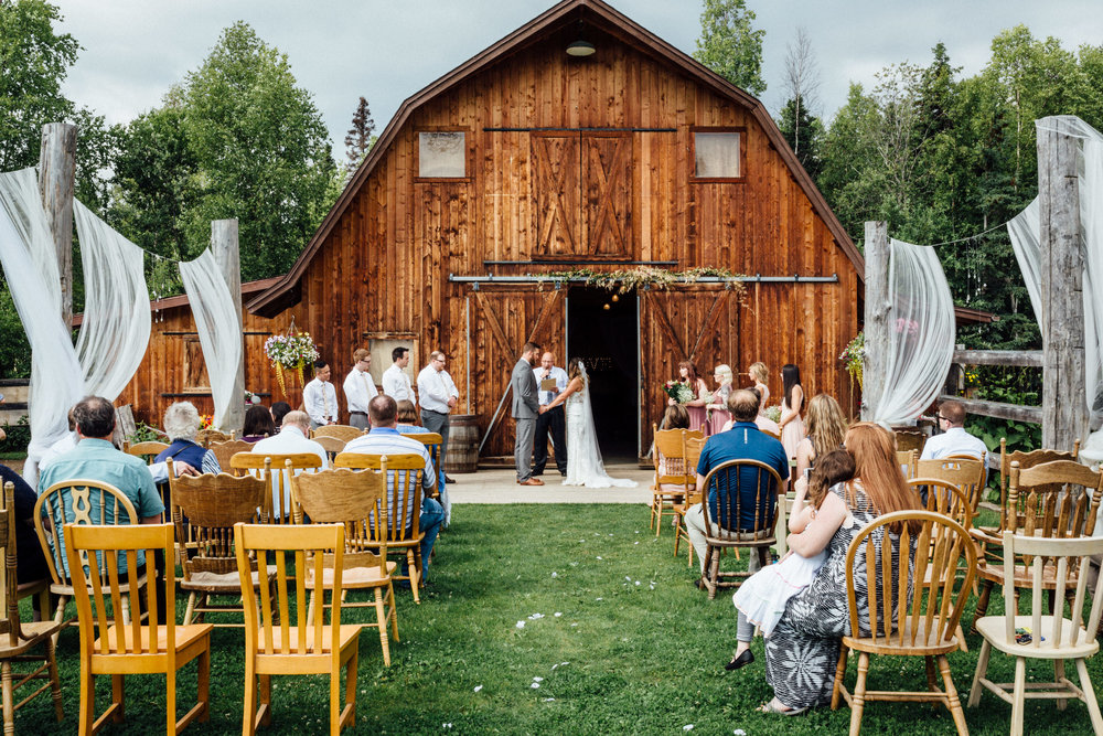 Outdoor wedding ceremony on the lawn of Gloryview Farm in Wasilla, Alaska