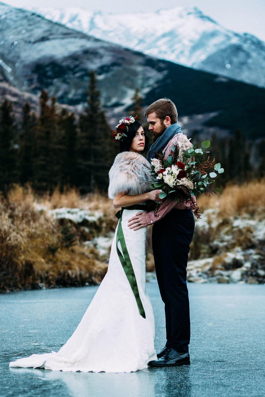 Bride and groom standing on ice in Alaska
