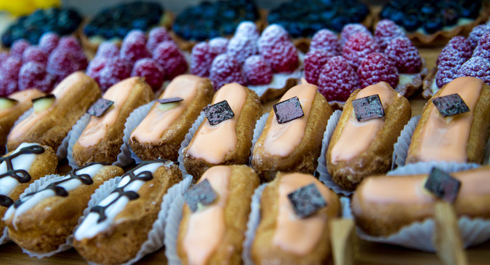 Thierry Isambert Culinary and Event design - Sunday Brunch Pastry Station with Traditional and Orange Eclairs, and Blueberry and Raspberry Tartelettes, prepared in our kitchen by pastry chef, Bruno Legros.
