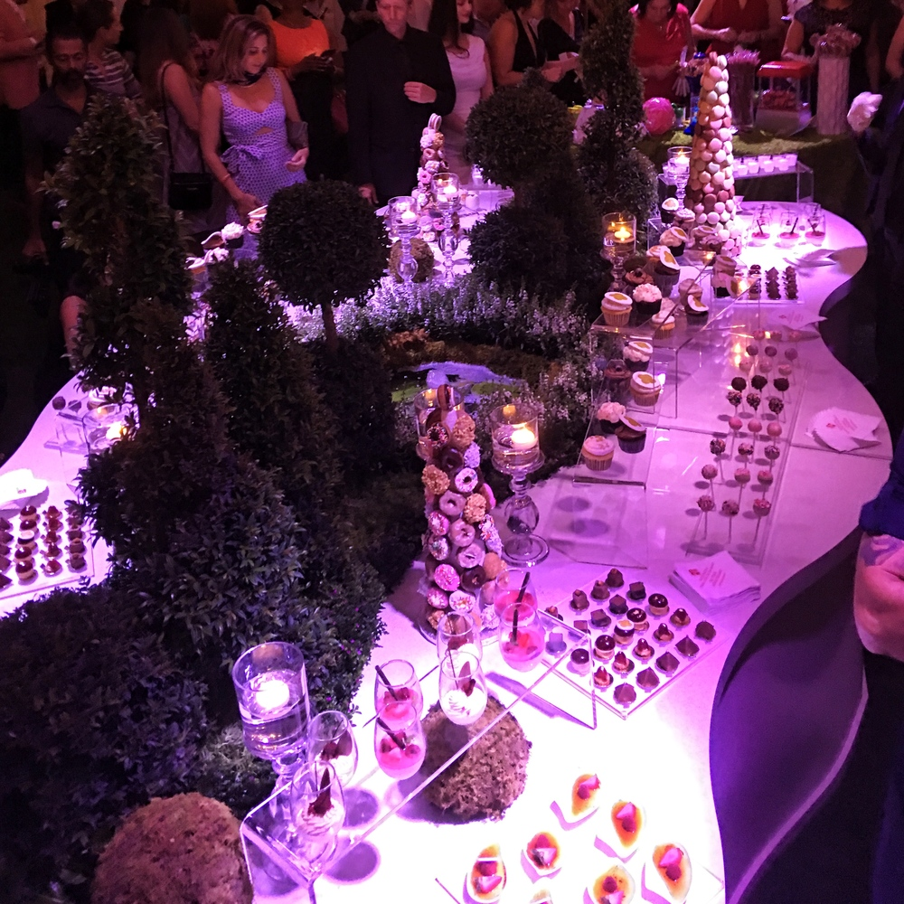 A deliciously tempting dessert station for a corporate event at Aqualina! Petit Fours: Mini Imported Valhrona Chocolates, Mini Fruit Tartlets, Espresso Parfaits, Assorted Macaroons, Crunch Praline Tower with Hazelnut Décor and Raspberry Mascarpone Fondants to name a few!