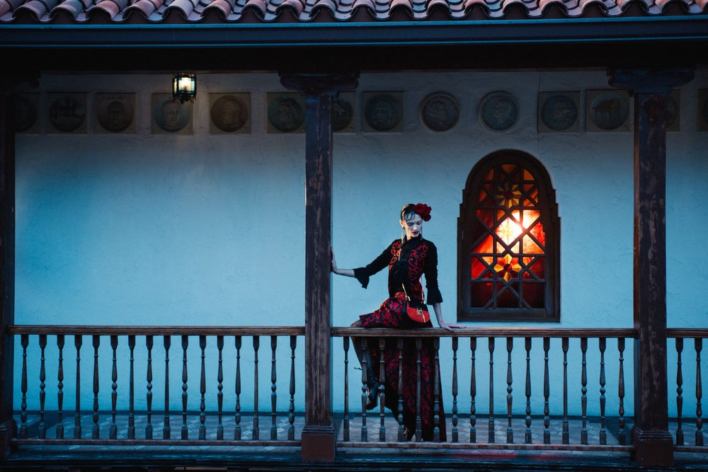 Model wearing a blouse by Chloe, and cardigan with maxi-skirt by Alice & Olivia, overlooking the historic courtyard from the second floor, just outside the Signature Suite's window (previously Gianni Versace's bedroom.)
