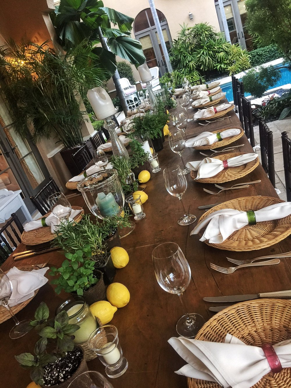 Talented event planners can help you design the perfect table for your Shabbat Dinners, from traditional styles to more personal or innovative decor. This table's centerpieces feature the herbs and plants that grow in the beautifully landscaped surrounding garden.