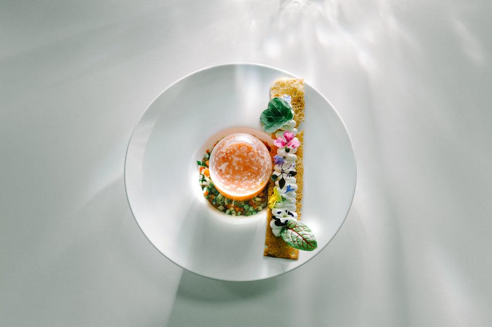 Thierry Isambert's Inverted Watermelon Gazpacho | Miniature Botanical herbs & Flowers on Brioche Lattice Crostini [Photo: Eric Monteiro]