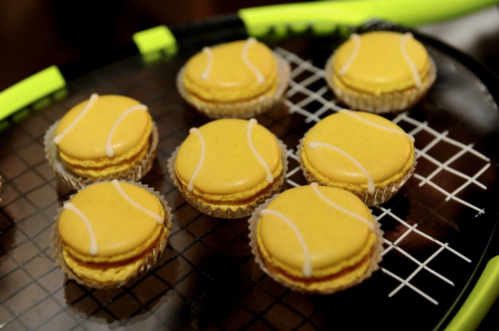 Lemon Macaroons with a tennis ball design