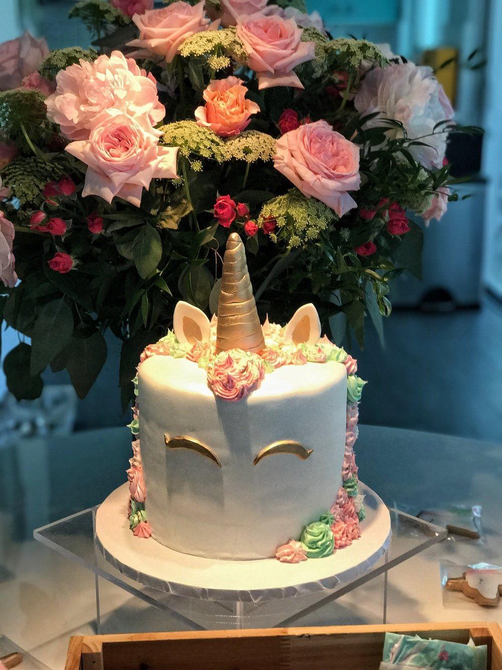 - A touch of whimsy with sparkling unicorn cookies and a custom designed unicorn cake from