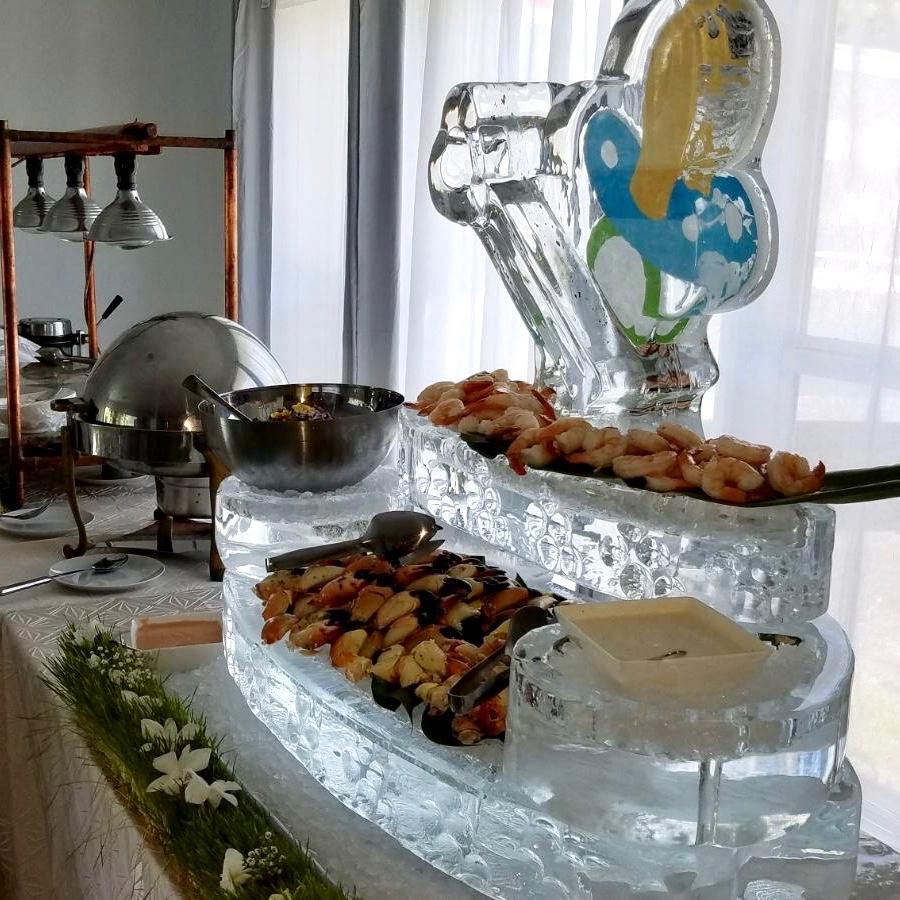 Raw Bar - Stone Crabs; Tuna Tartar &Jumbo Shrimp in a custom designed ice sculpture