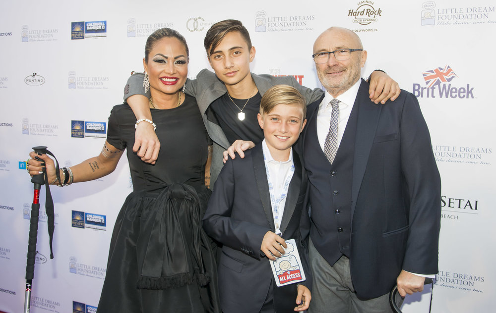ORIANNE & PHIL COLLINS WITH SONS, NICHOLAS AND MATTHEW [Photo: Courtesy of the LDF and Mitchell Zachs]