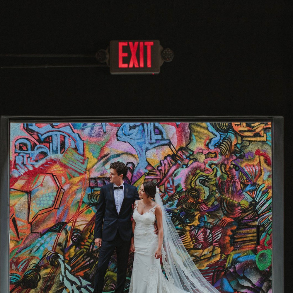 AN URBAN CHIC WEDDING IN WYNWOOD, MIAMI'S ARTS DISTRICT:  The bride's late father was a painter, and Maps Backlot provided the perfect backdrop to showcase her father's incredible artwork during the event.