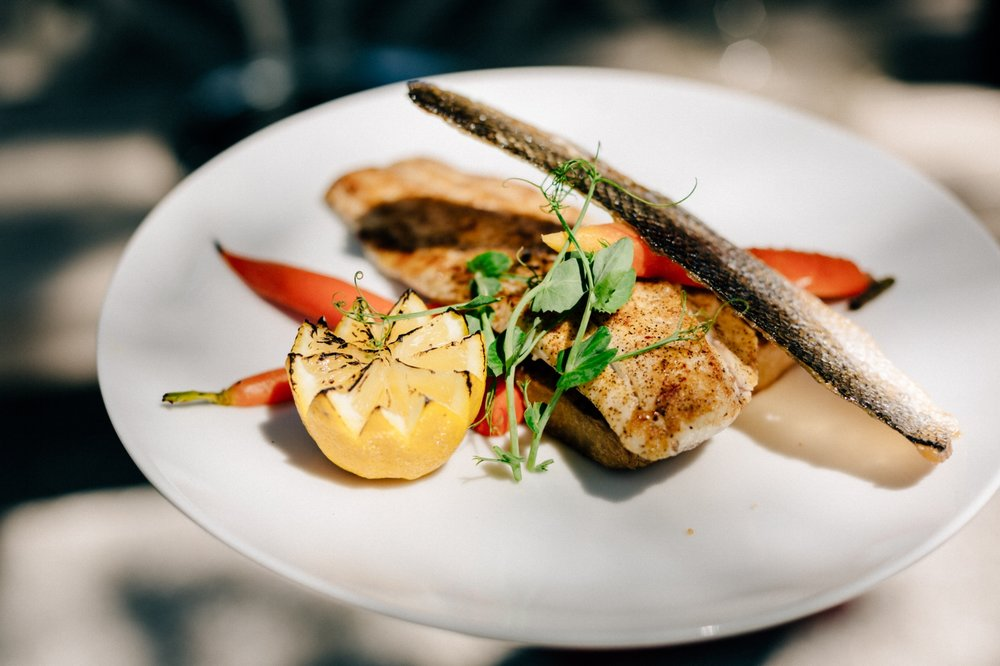 Pan-Seared Branzino, Crispy Skin, Leek & Potato Fondant, Baby Rainbow Carrots
