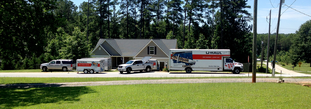 Moving day view of all 4 vehicles and trailers. Thank goodness for U-Haul.