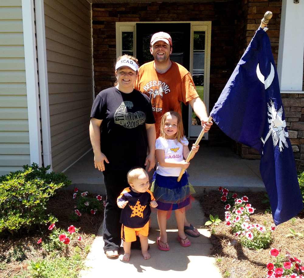 Our last family photo in front of our house after we took down our SC state flag.