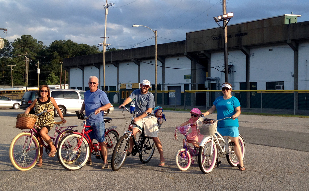 We made some time for a family bike ride with my parents around town and down memory lane. This is in front of our high school stadium, where my dad played football and I cheered.