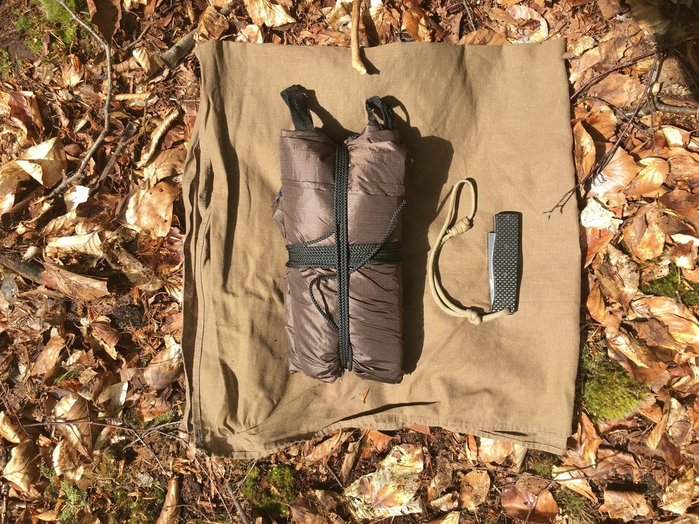 Here the tarp is packed up small, my pocket knife for scale.