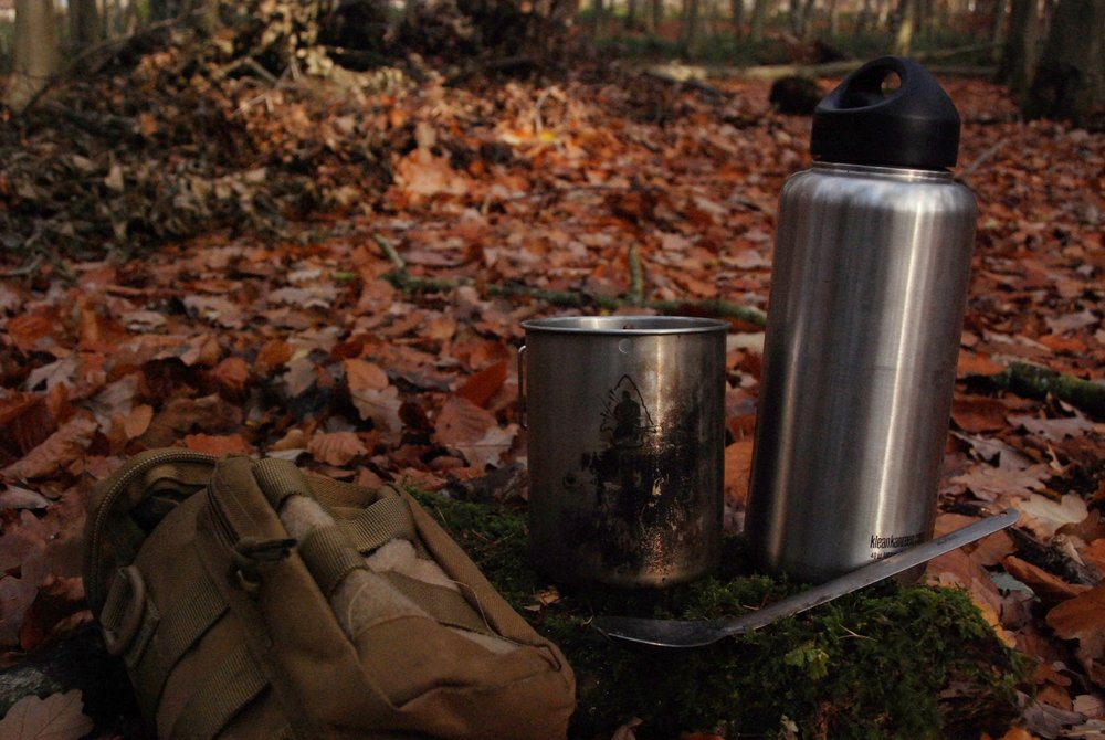 A tough water bottle was always going to feature in a 'what to carry' article, but you might consider taking a lightweight metal mug also. Should you find you need to produce more drinking water or are stuck out overnight then a metal mug will prove invaluable in boiling water by a fire. In the molle pouch I also have a few sachets of coffee, a metal spoon and a packet of purification tablets so that I may sterilise water without boiling it if need be.