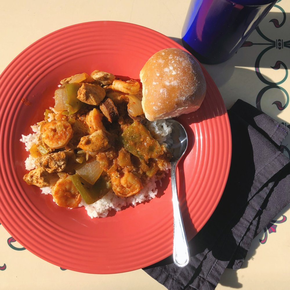 Jambalaya from French Market with my water bottle and napkin