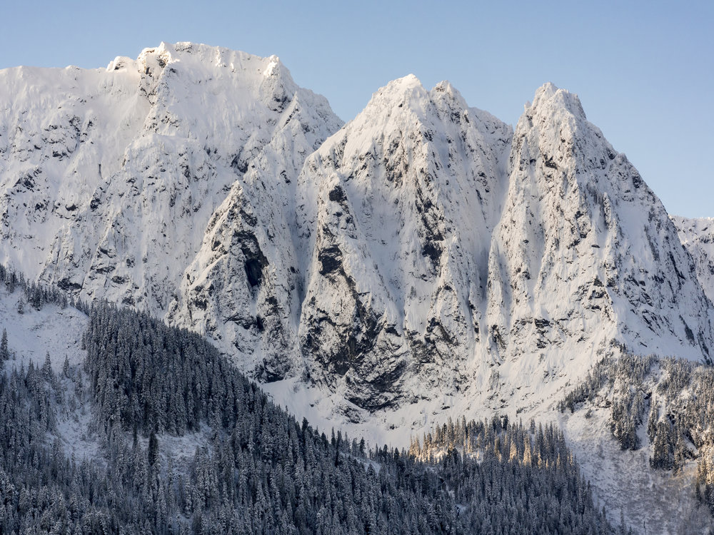 Amazing Detailed Sharp Peaks of Mount Index Covered in Winter Snow with Blue Sky Background
