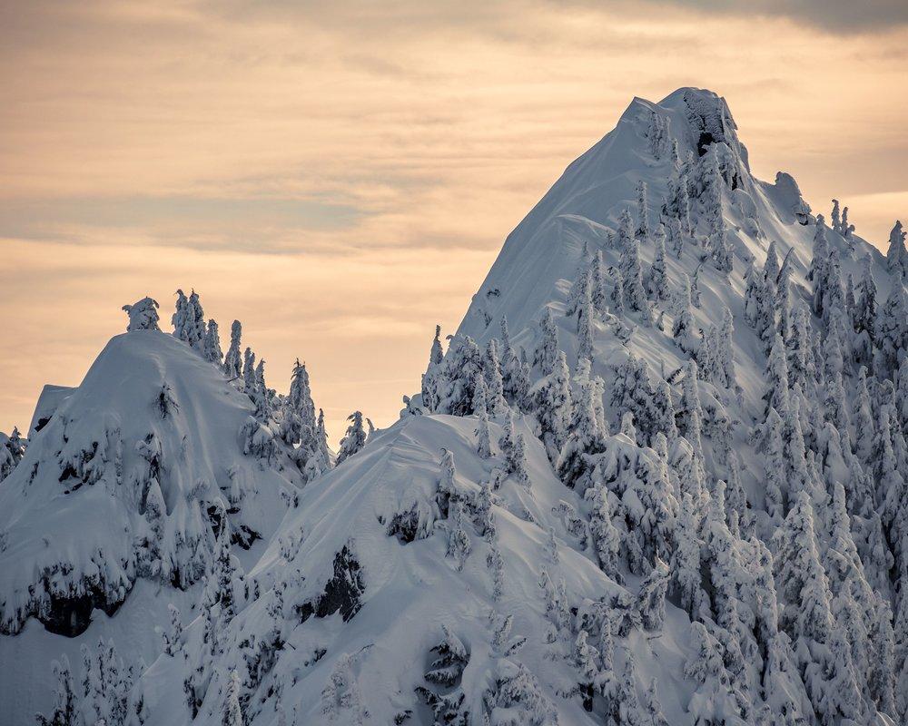 Vibrant_Winter_Sunset_on_Snowy_Fresh_Powder_Mountain_Peaks.jpg
