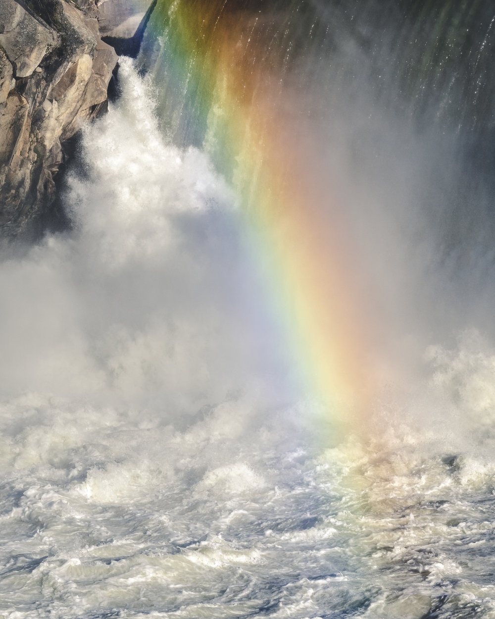 Colorful_Rainbow_in_Waterfall_Mist_Close_Up.jpg