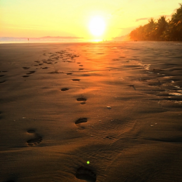 Costa Rican sunset - footprints in the sand