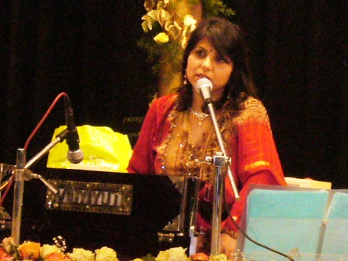 Swati Natekar singing and providing a melodious tune.JPG