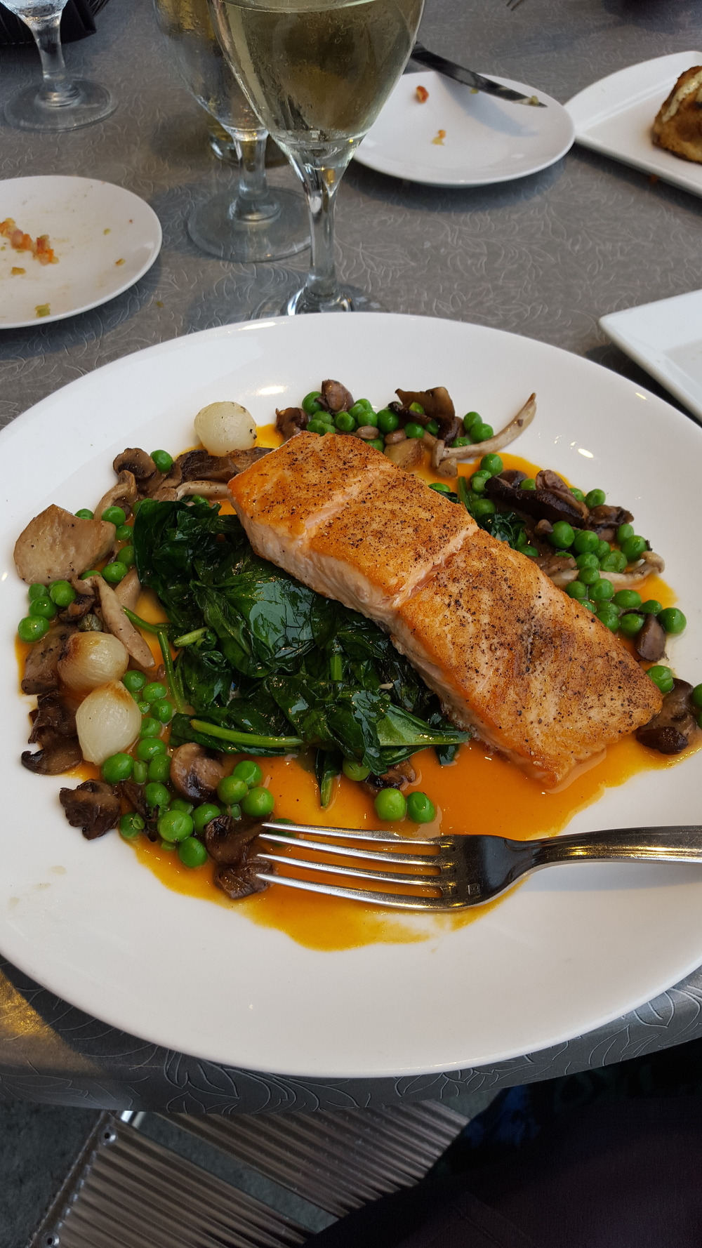 Fancy date night with delicious salmon, sauteed spinach, peas, onions, and mushrooms. Looks beautiful, tastes amazing, feels incredible!