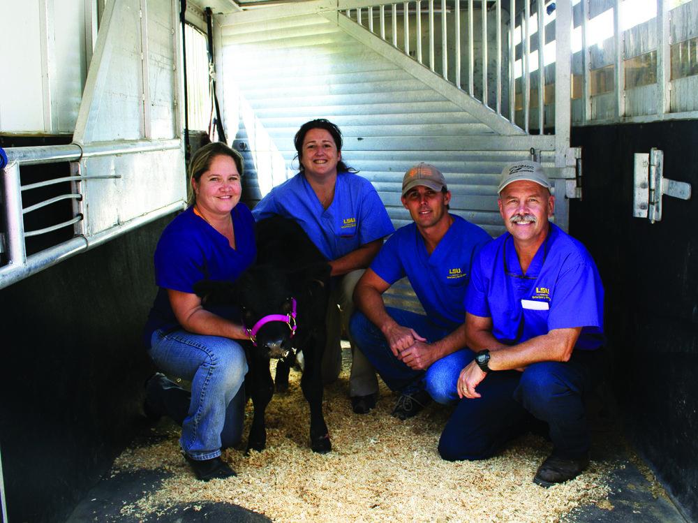 Poncho with vet team.jpg