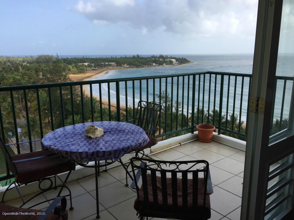 Renting a condo can be an economical option when traveling, especially when the unit has an equipped kitchen and in-unit laundry facilities. Shown here: morning view from the balcony of Dulces Sueños rental unit in The Towers of Luquillo, Puerto Rico