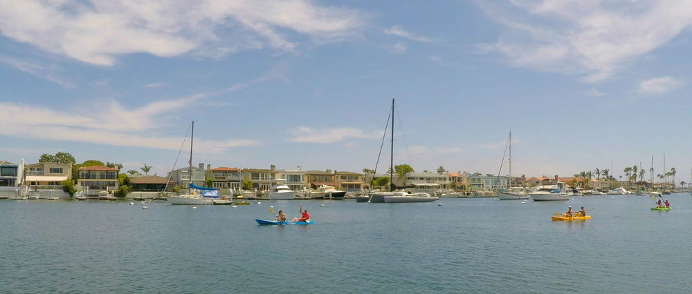 Less than half (45%) of the total area of Newport Beach is land. With 29.2 square miles of water, there is plenty of opportunity to participate in nautical sports of many kinds, including kayaking and stand-up paddle boarding on the calm waters of Newport Harbor.