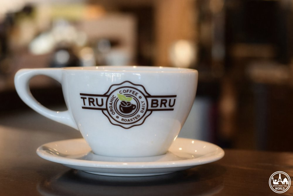 Third wave coffee arrived late, but hit hard in Orange County, California. Check out our five top picks for fair trade / direct trade coffee in this part of Southern California. Tru Bru Coffee, one of our picks for The Top 5 Fair Trade/Direct Trade Coffee Shops in Orange County, California - by Open Wide the World