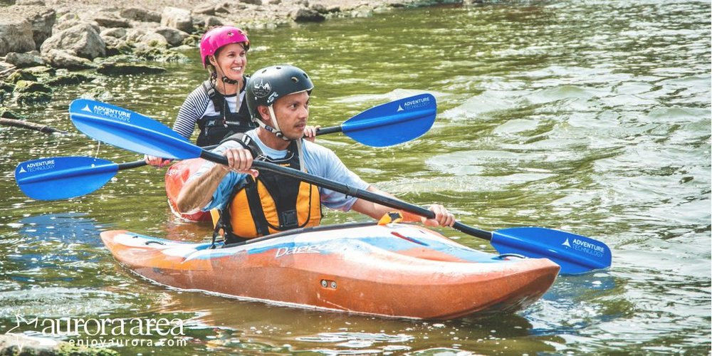 Judging from our smiles, our first whitewater kayaking lesson was a huge success! (Photo: James Cardis, Aurora Area CVB)