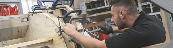 A craftsman clamps the pieces of the Morgan 4/4(below) frame together - made of Ash wood.