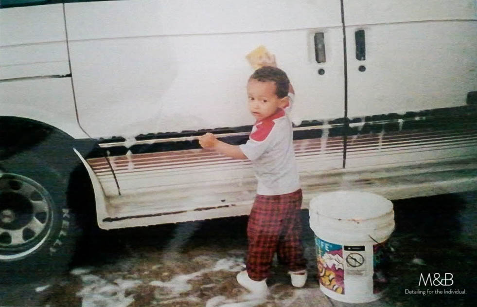 Two year old me (circa 1997). I loved to wash the bottom 3 feet of the cars in the family. Its all I could reach.