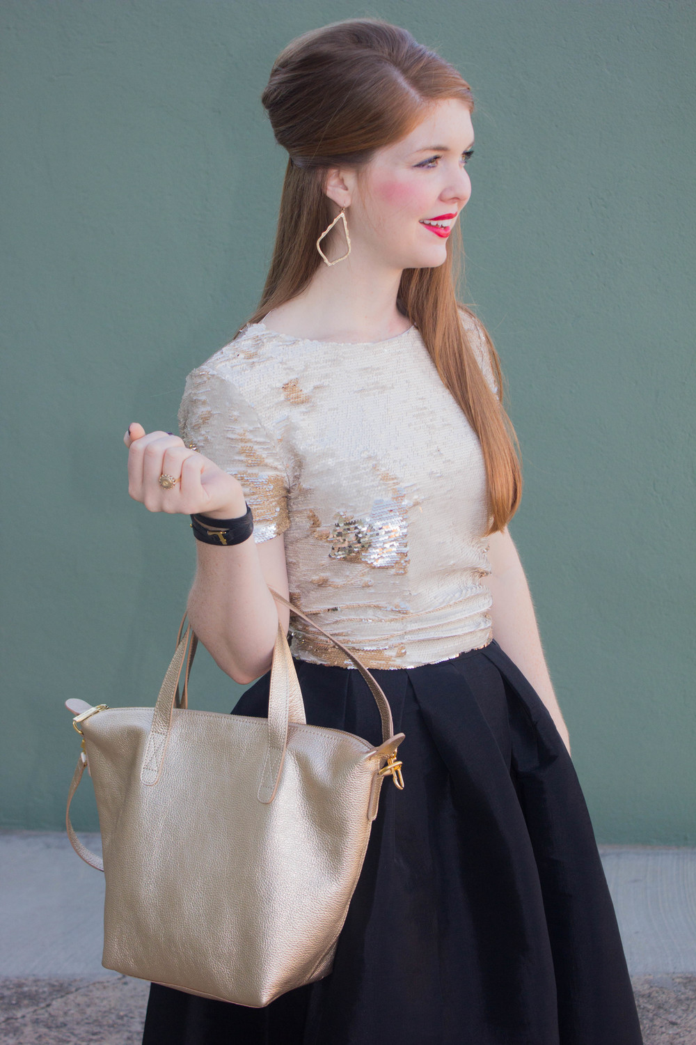 pleated black midi skirt, sequin top, cuyana carryall