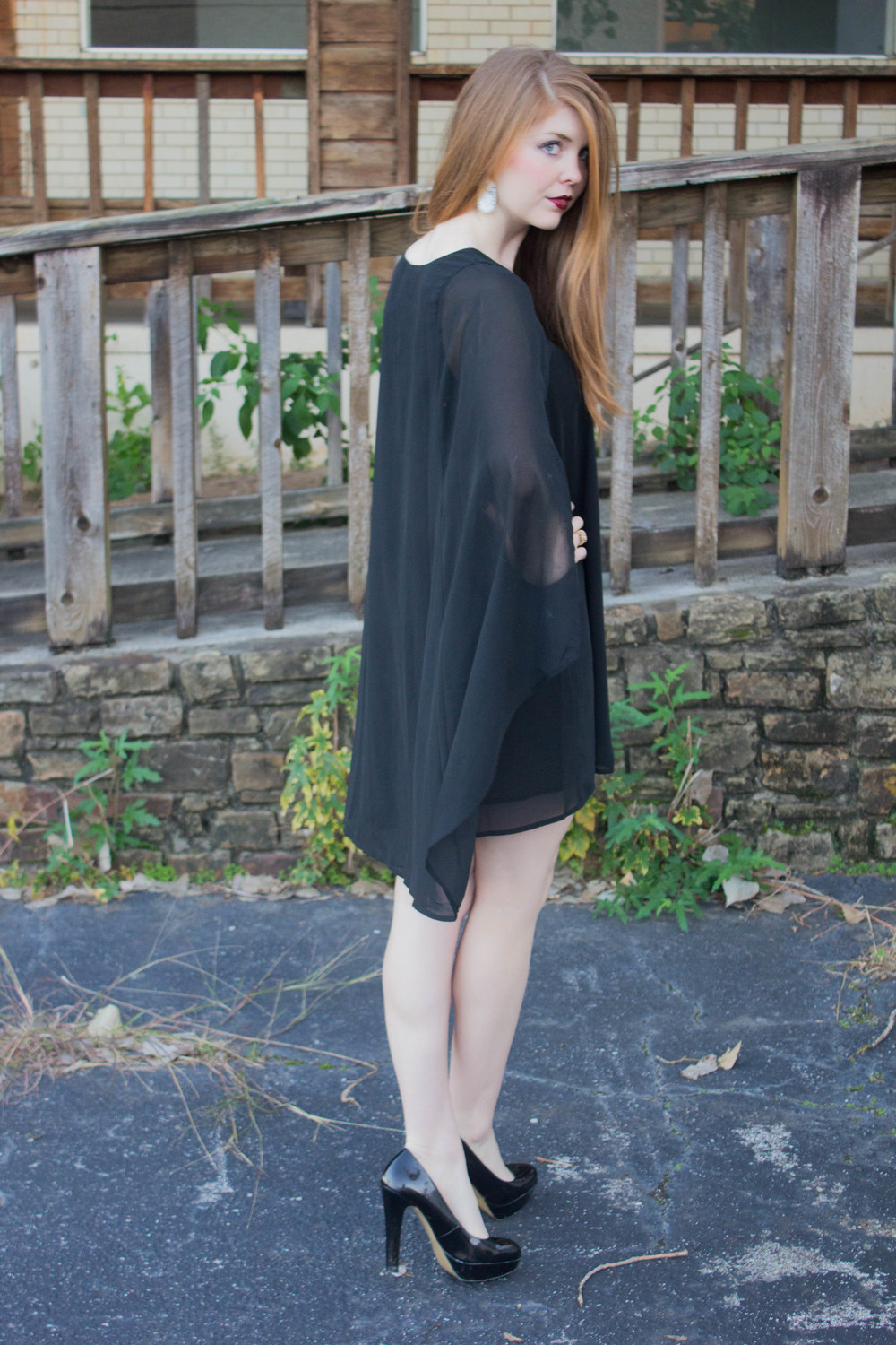 black cape dress, black patent heels, raybans