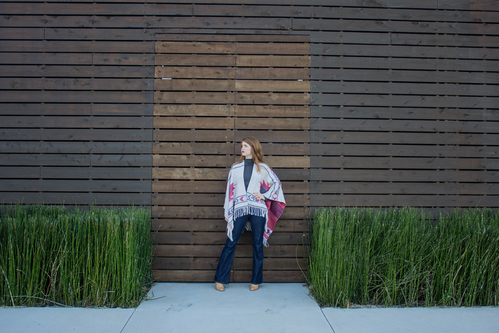 fringe poncho, denim flares, booties