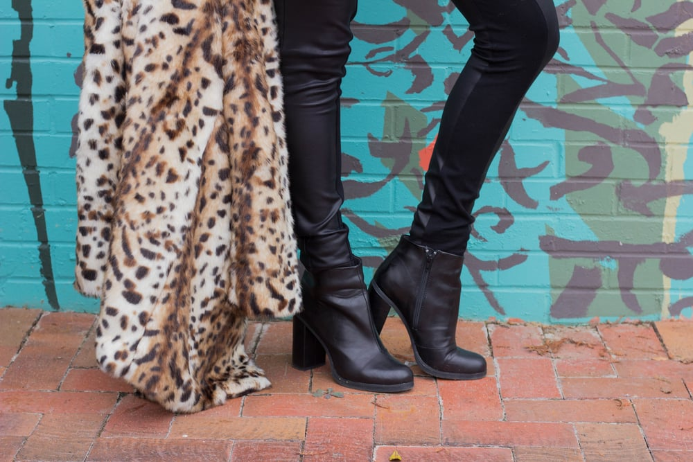 leopard coat, leather tights, black raybans, red lip