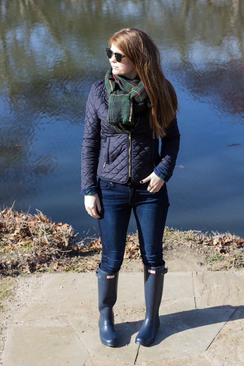 navy tall hunter boots, rayban clubmaster, green plaid blanket scarf, navy quilted jacket, fidelity jeans